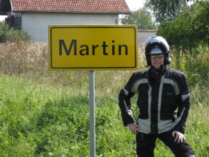 Martin poses next to the towns entrance